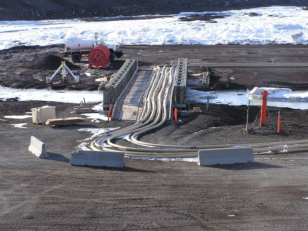 Six-inch fuel hoses on bridge to ice pier.