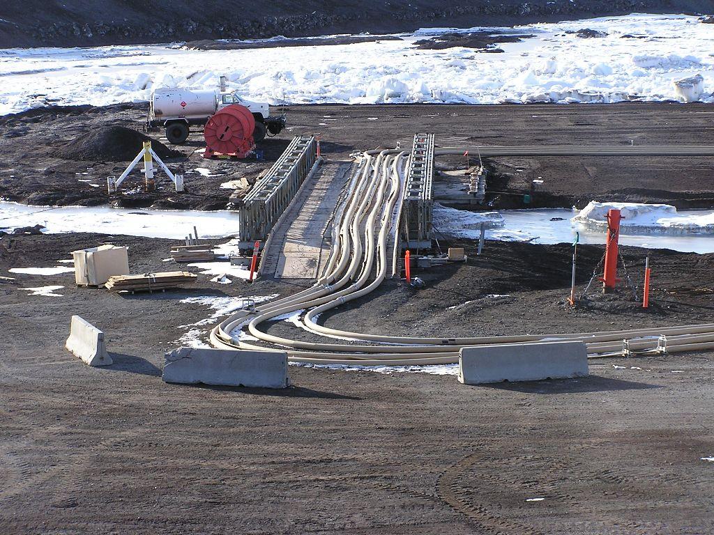 Six-inch fuel hoses on bridge to ice pier.