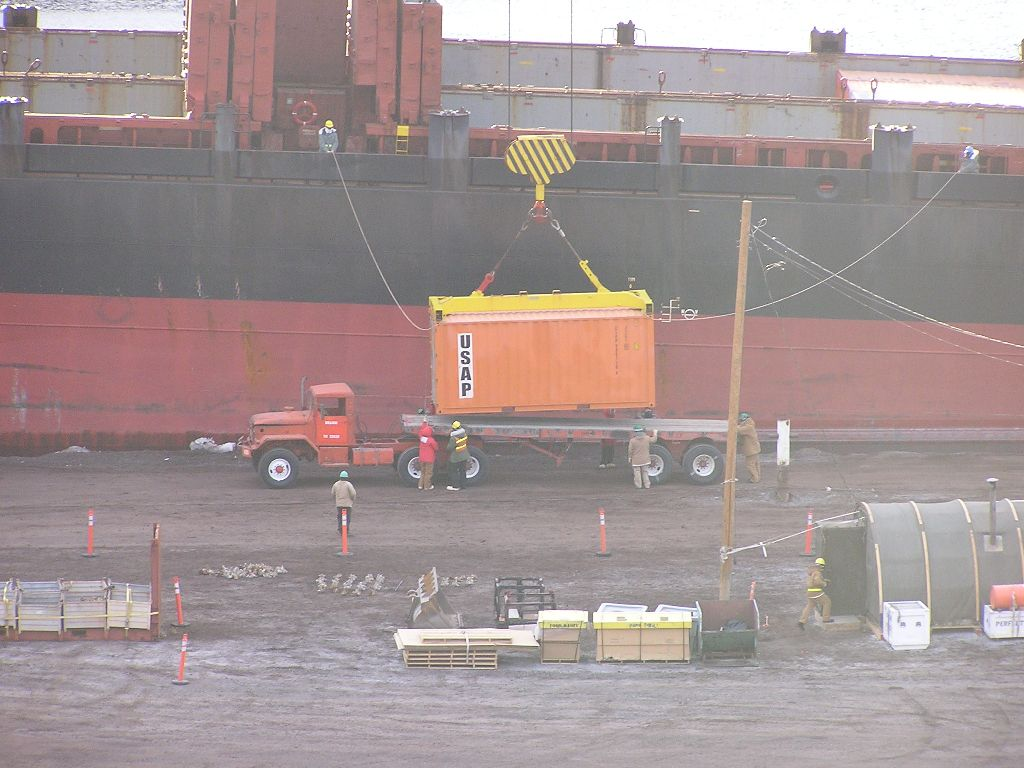 Cargo container being offloaded.